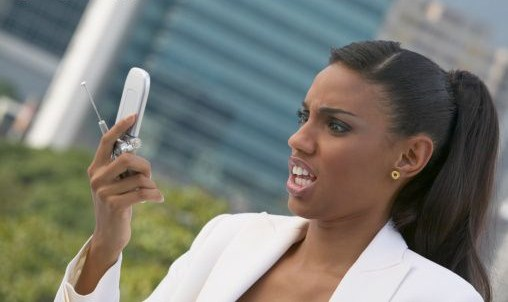 black-woman-looking-at-cell-phone